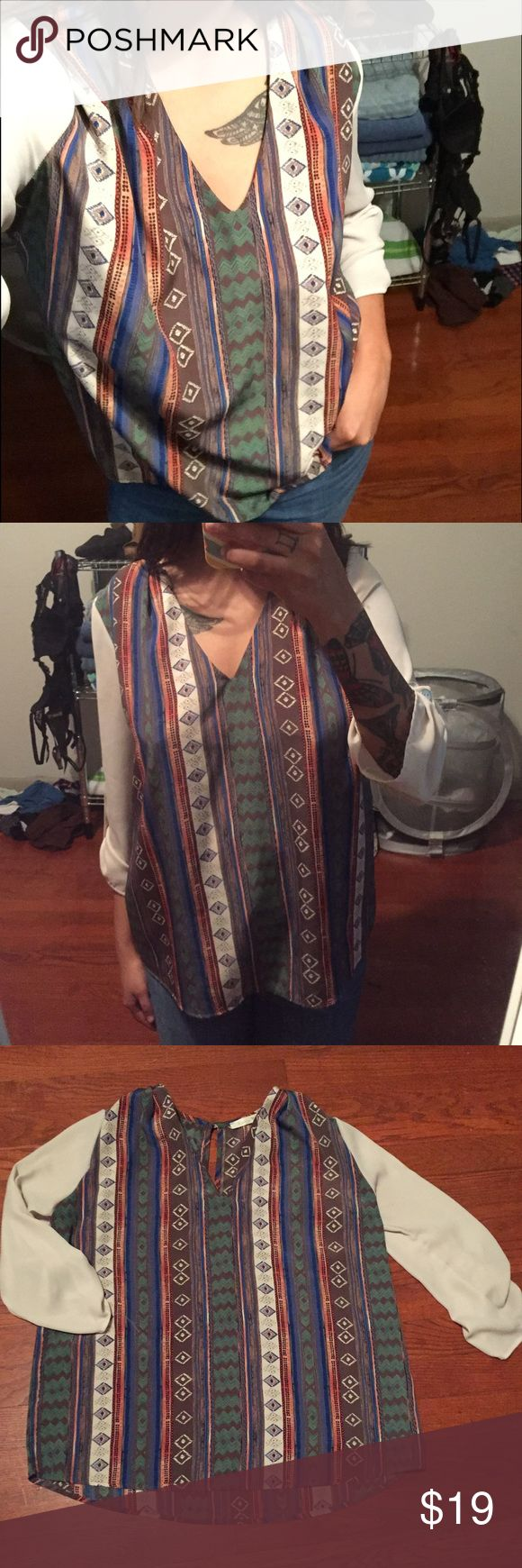 Aztec Top Pictures do not do this top justice. The colors are beautiful in person, it's very comfortable and silky soft. In great condition, bought this top at a flea market here in Austin, I just don't wear it anymore. Tops
