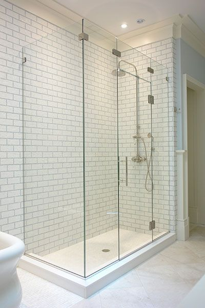 """90 degree corner frameless enclosure with glass bridge, using nickel hardware, ½"""" thick starphire glass and 8"""" ladder style pull. Glass is coated with Shower Guard protective coating to minimize staining. #ShowerEnclosure"""