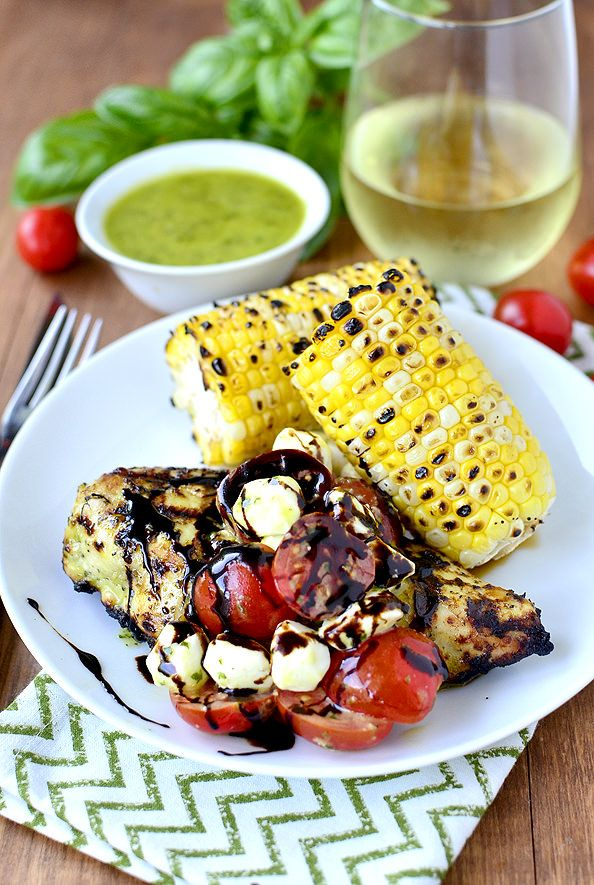 Gluten-free Grilled Caprese Chicken with Basil Vinaigrette uses the same basil vinaigrette for the chicken marinade and salad dressing. Fresh and so tasty!   iowagirleats.com