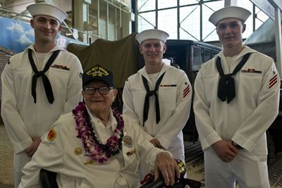 "Pearl Harbor survivor Jim Downing visits with sailors at a screening of the ""Remember Pearl Harbor"" documentary at the Pacific Aviation Museum at Pearl Harbor, Hawaii, Dec. 4, 2016. DoD photo by Lisa Ferdinando"