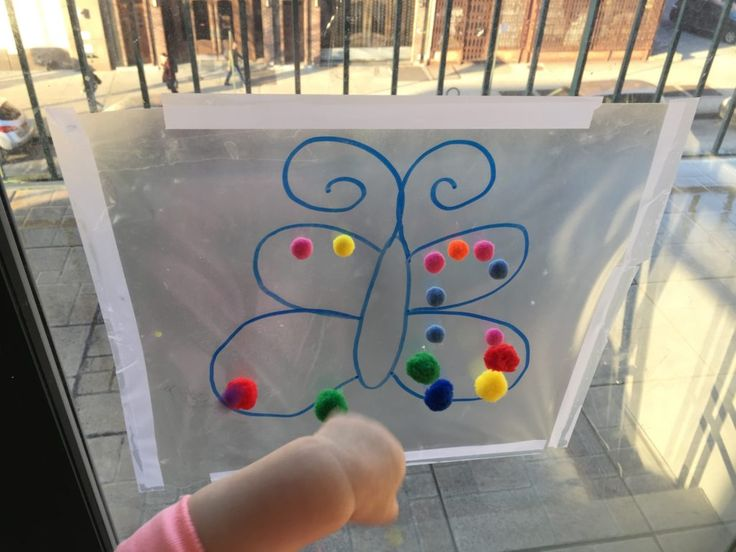 Toddler Activity – pom poms and contact paper!