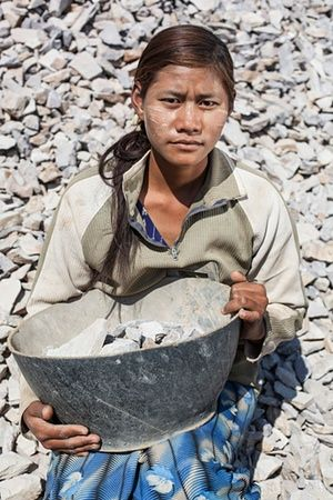 Women of Myanmar: Empowered or Exploited? (A road worker near the city of Kyaukme, Shan state).