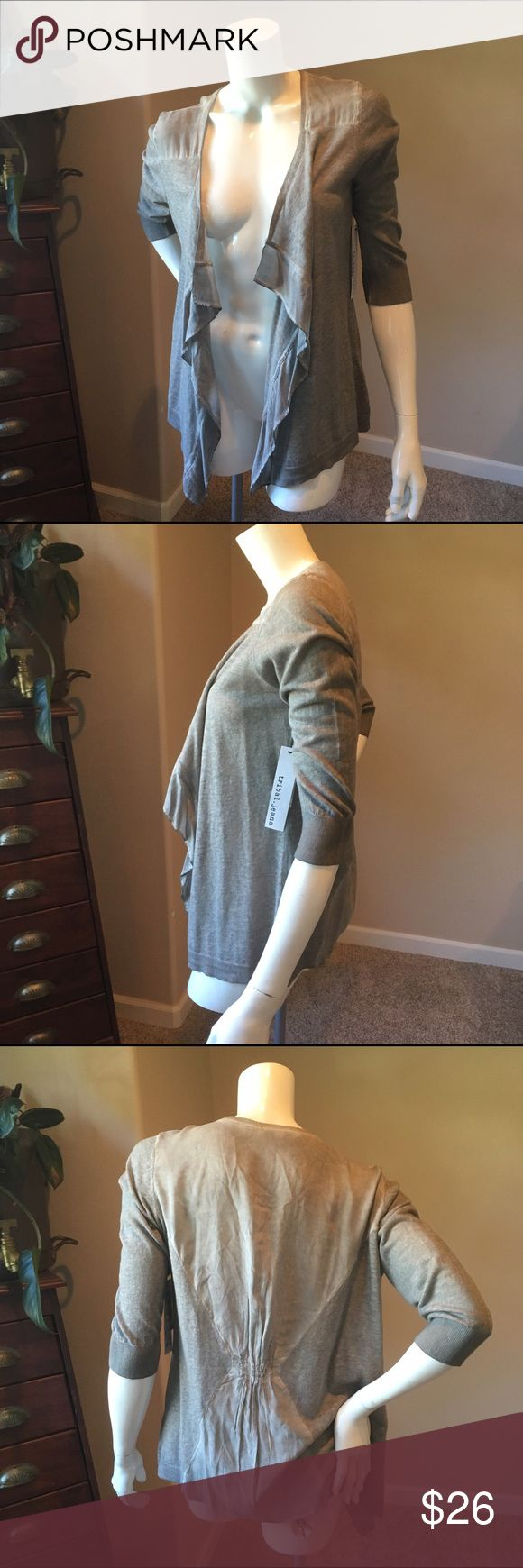 Tribal S NWT grey linen cardigan Tribal S NWT grey linen cardigan . This top is comfortable and has a slight tie dye wash to it. Perfect lightweight piece for layering. Measurements will be posted soon Tribal Sweaters Cardigans