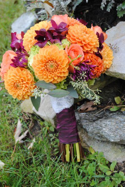 Wedding Bouquet: Bright orange dahlias with purple orchids and seeded euc accents. / www.waterviewcatering.com