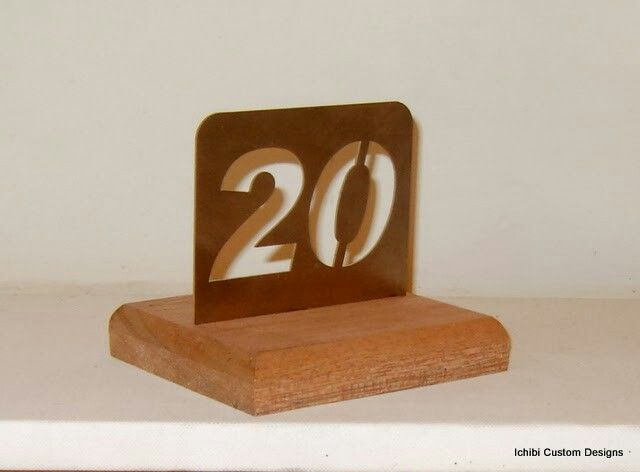 Stainless steel with wooden base table numbers.