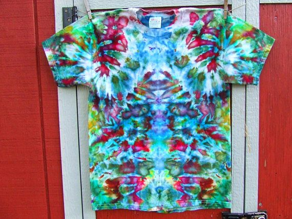 Twirlytoes tie dye T-shirt featuring a trippy design in so many colors! Dyed using a combination of ice cubes and procion pigment powders. The melting ice decides on the final pattern, so no two ice dyes are alike!  Hanes Beefy 100% Cotton T-shirt, size adult Medium, preshrunk and ready to