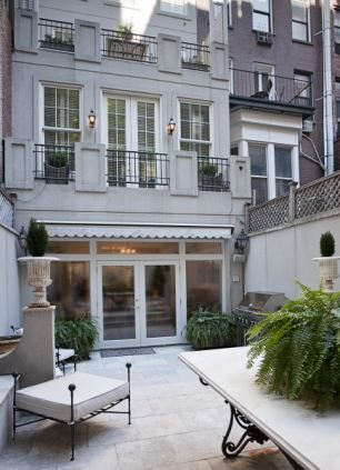 Euro-style: Lagasse bought the house from UK developer Penny Bradley, who renovated the property leaving some British touches including the bright red door and a European style paved garden.