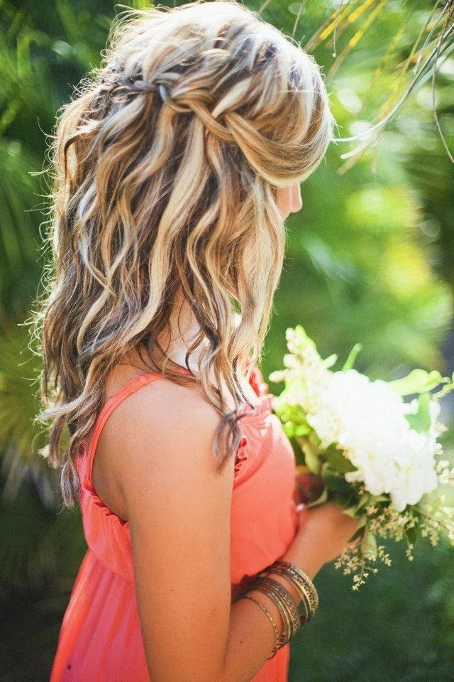 Tousled beach waves and coral bridesmaid