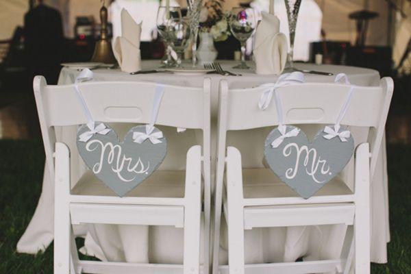 Mr. and Mrs. chair back signs // photo by Lauren Fair // view more: http://ruffledblog.com/romantic-pennsylvania-wedding