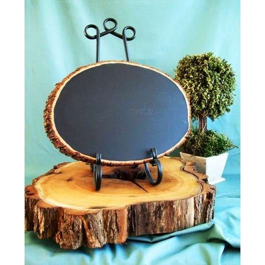circle from a tree painted with chalk board paint!