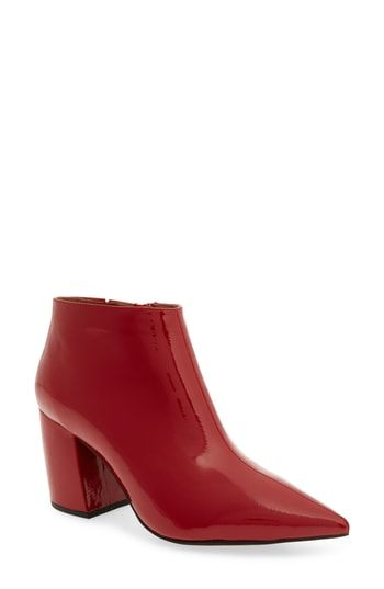 bfd56447cbf An angled demi-block heel leans back into a curvy profile behind a simply  styled bootie cut with a dramatically pointy toe that gives t…