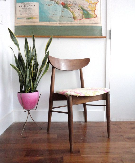 mid century modern chair and bullet planter