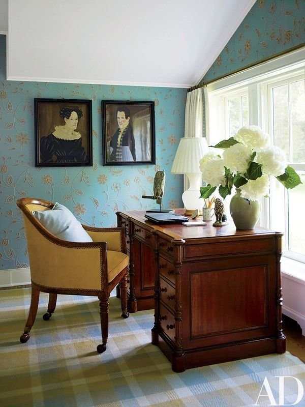 A Ranjit Ahuja embroidered linen sheathes the master bedroom walls; the Victorian desk is from Florian Papp | archdigest.com