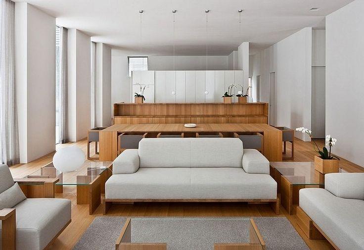 Getäfelt und eckig: dieses moderne, eckige und maskuline Haus hat eine hölzerne Lattenfassade