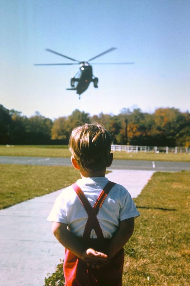 "John, Jr. waits to to greet President JFK's ""hebrecop"" on his arrival at Camp David, October 12, 1963, photo by Stanley Tretick."