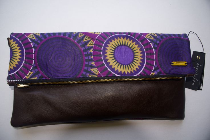 OneOfEach African waxed fabric and leather clutch bag