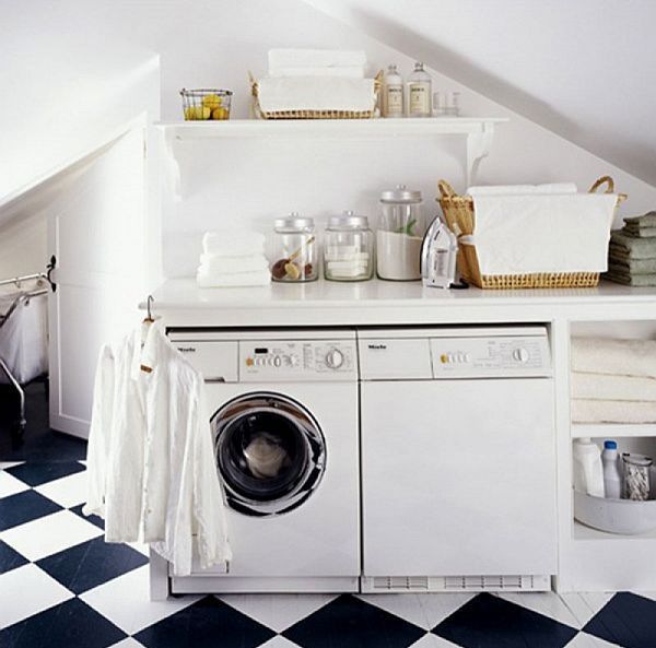 laundry room with black and white tiled flooring
