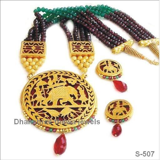 This is thewa Art Jewellery, in Thewa Jewellery 23ct Gold work on glass.... Manufacturer--- Amit Soni +91-9309099474, +91-9414735634 www.thewa.org