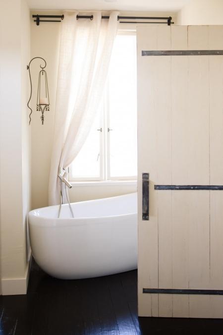 Modern country bath w/ plank door by Ben Riddering