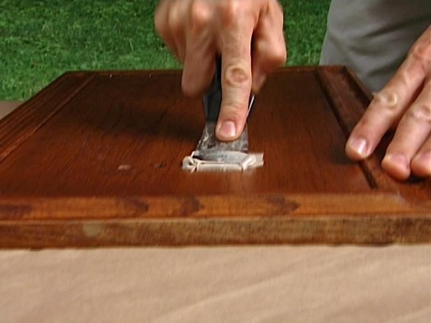 DIYNetwork.com has step-by-step instructions on how to paint wooden kitchen cabinets.