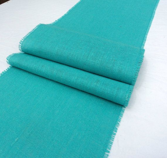 This shade of aqua burlap is absolutely stunning!  Perfect for your beach wedding or coastal style home decor.  This burlap table runner measures