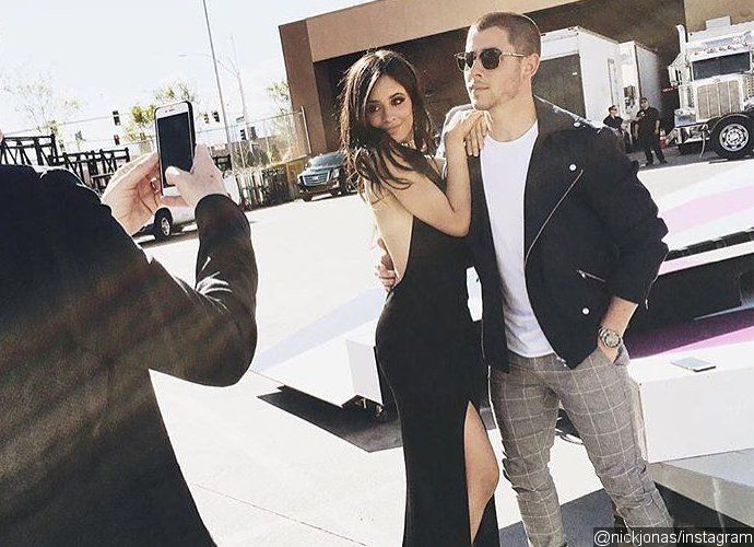 Nick Jonas Posts Throwback Picture With Camila Cabello, Fans Urge Him to Date Her After the former Jonas Brothers member posted a photo of himself getting close to the Fifth Harmony member, fans can't stop shipping the two. Source The post Nick Jonas Posts Throwback Picture With Camila Cabello, Fans Urge Him to Date Her appeared first on Fever Magazine . https://www.fevermagazine.com/2016/06/16/nick-jonas-posts-throwback-picture-with-camila-cabello-fans-urge-him-to-date-..