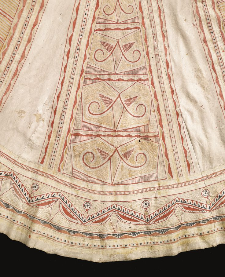 Naskapi Painted Hide Hunting Coat styled in the manner of an 18th century riding coat, sewn of tanned caribou hide, painted in red, cream, and black pigments, the front and back decorated with tapering panels enclosing stylized symbols, possibly representing caribou, the arms, with bands of trapezoidal designs