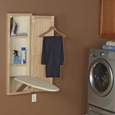 Ironing Board Cabinet - i need this. There was one built into the other house we almost bought, but not this one!