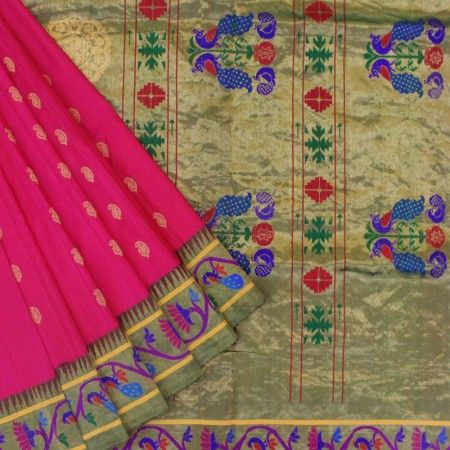 Gorgeous pink coloured base with all over paisley motif and contrasting green paithani pallu.The border has beautiful bel with peacock and floral motif in gold zari.