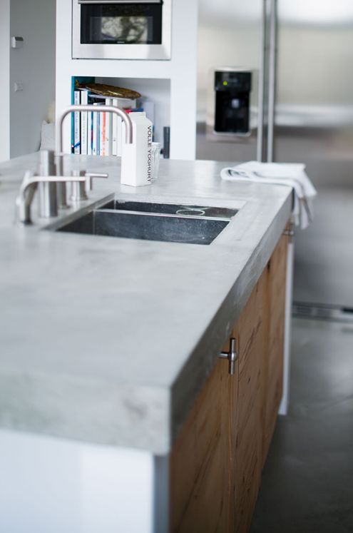 Close up of polished concrete worktop with built-in sink. So so lovely this texture