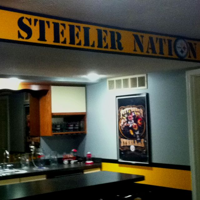 """My husband's Steeler Room. Just finished the """"Steeler Nation"""". Used 400 pt. """"Stencil"""" font in Word to create the stencil. Used Mod Podge to create the plaque for the """"O"""" in Nation."""