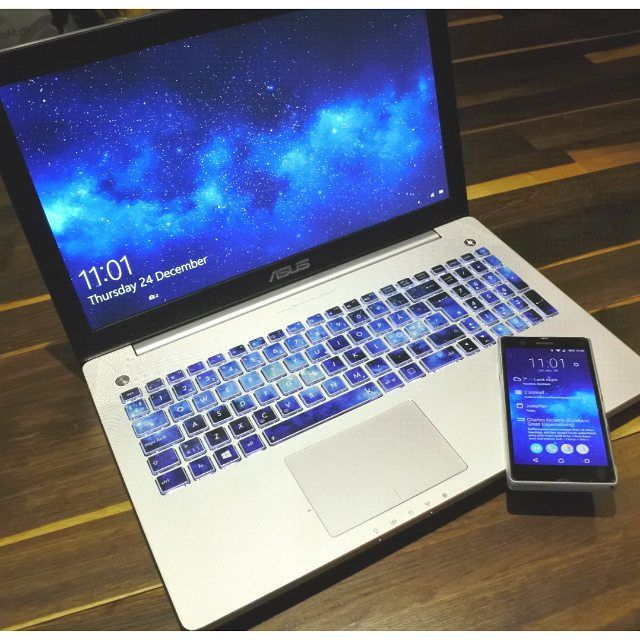 Asus keyboard stickers with blue nebulae by Keyshorts