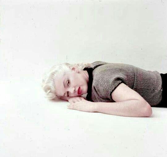Marilyn. Trestle sitting. Photo by Milton Greene, 1955.