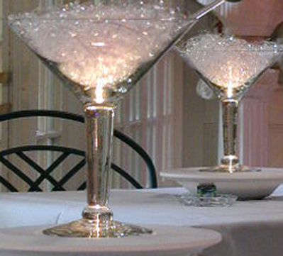 Giant martini glasses filled with crystal fibers with light up olive picks to put on cocktail tables!!!! <3