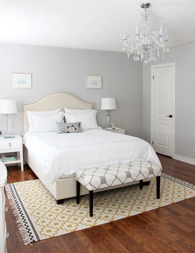 A light gray shade will give your bedroom a romantic, classic feel that's enhanced with a touch of modernity. Use bright white linens to bring out the wall's pale color.