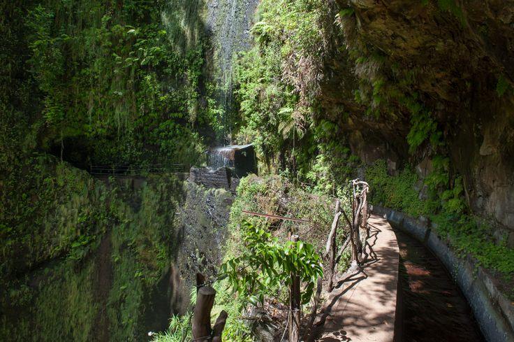 Hiking: Waterfall and tunnels along the Levada Ribeira da Janela. Madeira - Portugal