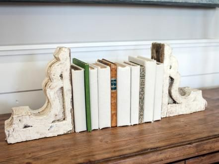 Visually arresting accents with a nod to the past are one of Joanna's decorating trademarks – as seen here in these antiquarian and linen-wrapped volumes bookended by antique wooden corbels.