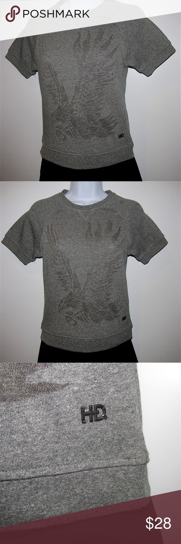 """Harley Davidson Motorcycle XSmall Crop Top NWT Great Harley Davidson Motorcycle gray logo t-shirt top, ladies size XSmall. •Banded scoop neckline •Raglan banded sleeves •Wings-up logo •""""HD"""" logo •Banded hemline Measurements •Length shoulder to hem: 20.5"""" •Width across front at underarm: 16"""" •Sleeve length: 6"""" Fabric content: 57% cotton/43% polyester Garment care: Machine wash cold, tumble dry low Harley-Davidson Tops Crop Tops"""