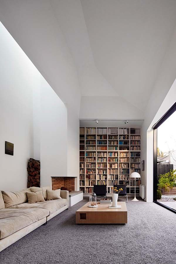 bookcase floor to ceiling next to glass ceiling high but wood not white