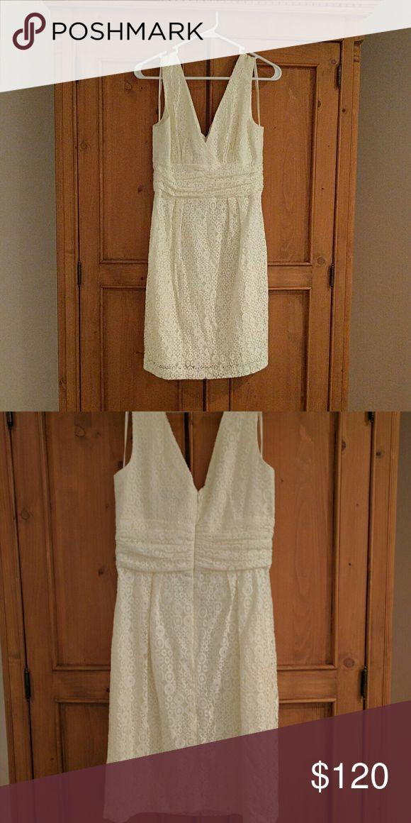 Trina Turk dress Size two ivory Trina Turk dress. Looks great on. I only wore it once to my rehearsal dinner. Trina Turk Dresses Mini