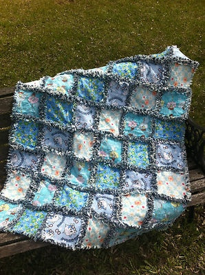 This Baby Blue Rag Quilt is 40 x 30 inches. It has flowers, Ballerinas, and more it is very cute. The back is made from recycled denim  $76.99