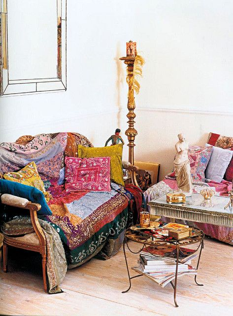 Love the antique sofa overflowing with colorful Boho throws