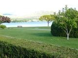 Idle O Apartments seldom offered for sale,just south of Haynes Point situated on the Shores of Osoyoos Lake.Covered carport for boat or car storage. 1 bdr, 696 sq ft. The monthly fee of only $219 per month includes taxes, water, sewage treatment plant on site, garden area, BBQ area, large 10x14 shed with plenty of storage space plus extra storage lockers under the recreational hall.Large workshop area. Okanagan Wine Country B.C. Canada Golf, Ski... sun sun sun $199,000