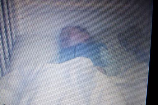 Mum horrifed when she spots 'ghost' baby climbing into 18-month-old son's cot as he sleeps