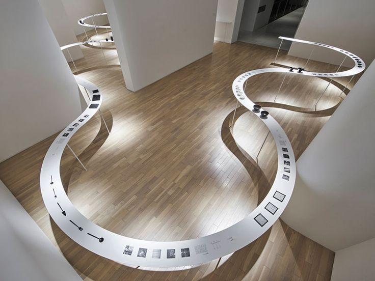 A table that snakes through various rooms at Tokyo's Eye of Gyre gallery by Japanese studio Nendo.