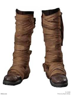 Wrapped boots for trekking through the deep forests. THIS. IS. A. BRILLIANT IDEA! If you have boots that aren't quite 'fantasy/post-apoc' like, get some linen and tear it in long strips (or coffee stain cheese cloth) and wrap it around your not-so-fantasy-boots