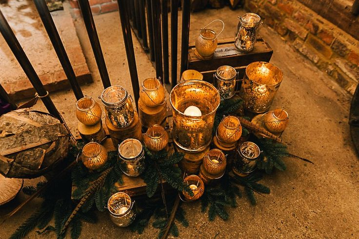 Candles in gold tealight holders bring warmth to a winter wedding