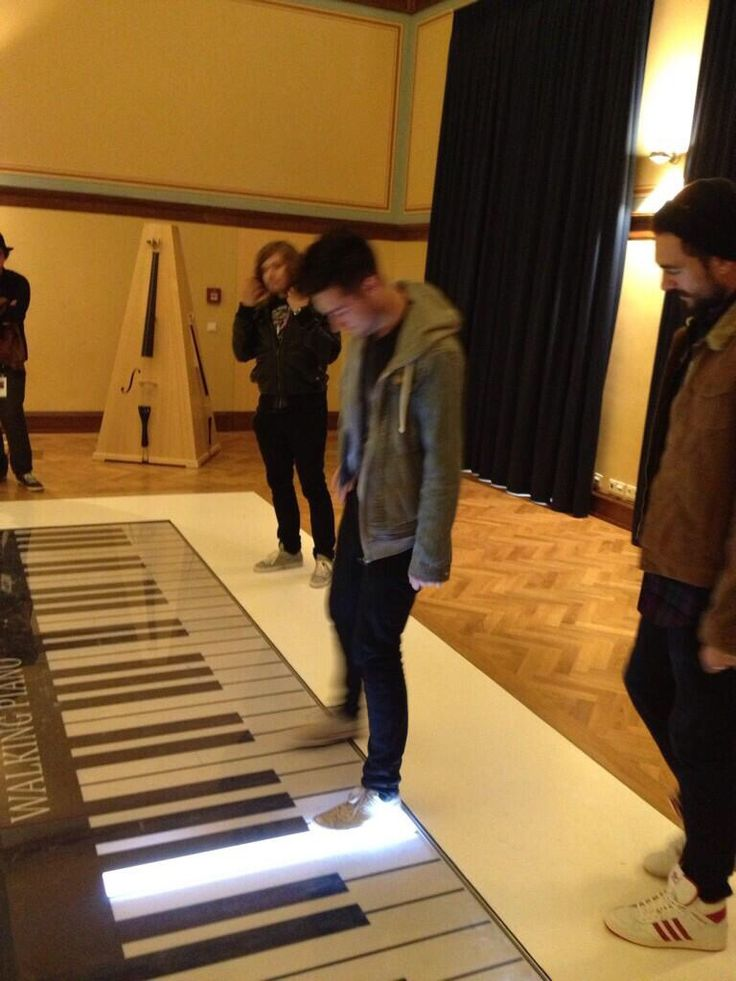 Dan Smith of Bastille, featuring a giant piano