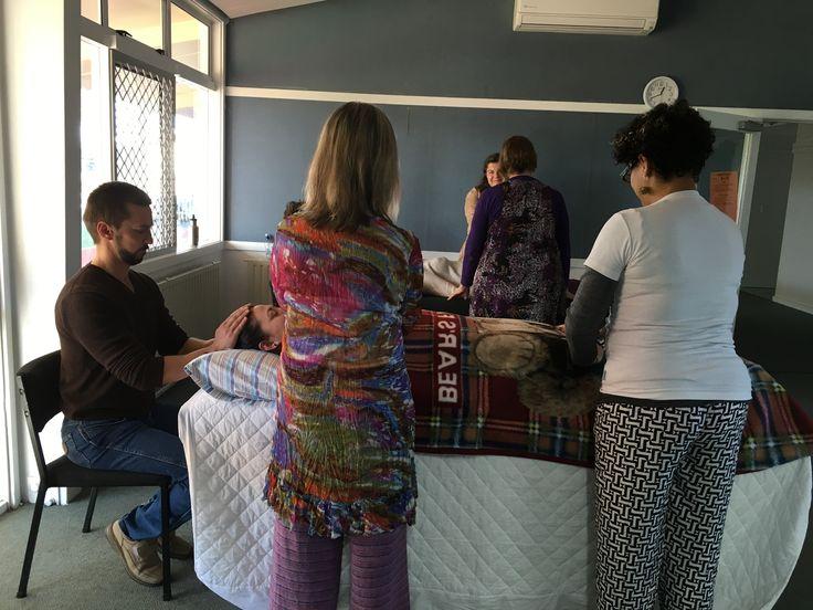 Reiki 1 2 3 at Silverdale School Hamilton, June 2016 - Waikato Reiki Committee. (1) Self Reiki; (2) Reiki with partners seated; (3) Reiki in groups on tables.