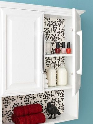 I like this idea to liven up the bath with a bold design.  I would use cardboard covered in cloth or shelf liner for a quick change
